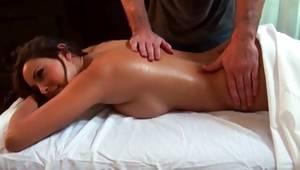 Topless brunette floosie massaged on her back